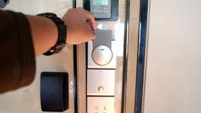 Hand inserting a keycard to unlock door. Male hand inserting a keycard on the security door system to lock and unlock door. Shot in 4k resolution stock video