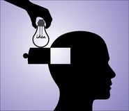 Idea in Head - A hand inserting an light bulb idea Royalty Free Stock Image