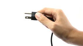 Hand inserting power plug Stock Photography