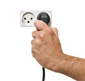 Hand inserting power plug to socket Stock Images