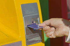 Hand inserts ATM card. Stock Images