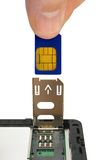 Hand install sim card. To mobile phone, close-up, isolated on white background royalty free stock image
