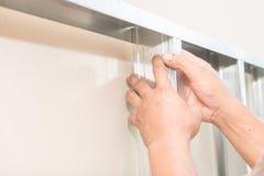 Hand installing aluminium sheet Stock Images