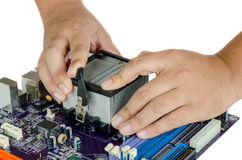 Hand installing CPU and Heat Sink Stock Photography