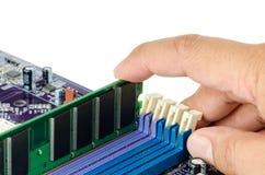 Hand installing Random Access Memory (RAM) Royalty Free Stock Image