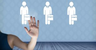 Hand interacting and choosing a person from group of people icons. Digital composite of Hand interacting and choosing a person from group of people icons Royalty Free Stock Images