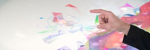 Hand interacting and touching air with bright colorful polygons background Stock Image