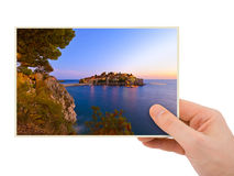 Hand and Island Sveti Stefan - Montenegro my photo. Isolated on white background Royalty Free Stock Images