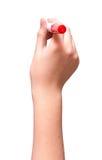Hand ist zum Zeichnen mit der roten Markierung bereit, die auf Weiß lokalisiert wird stockbilder