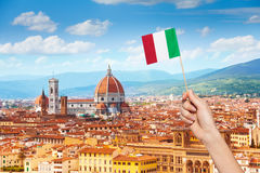Hand with Italian flag and cityscape of Florence Stock Photo