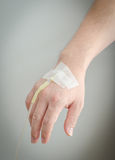 Hand with IV infusion Stock Photos