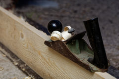 Hand jack-plane and wood chips. Small DOF. Royalty Free Stock Photos