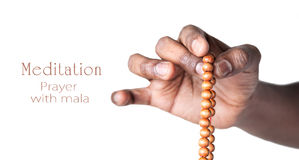 Hand with japa mala beads Stock Photos