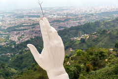 The Hand of Jesus. View of the hand of the El Santisimo statue in Floridablanca, Colombia with Bucaramanga visible in the background Royalty Free Stock Photos