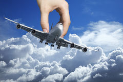 Hand with a jet plane Royalty Free Stock Images