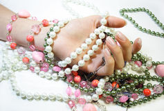 Hand and jewels Royalty Free Stock Images