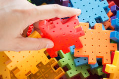 Hand on jigsaw puzzle game Stock Photos