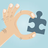 Hand with jigsaw puzzle Stock Photo