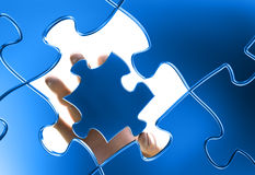 Hand joining a  puzzle Stock Photography