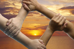 Hand joining with sunset background Royalty Free Stock Photos