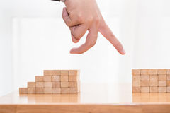 Hand jump through the gap between wood block, Jump over obstacle Royalty Free Stock Images