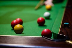 A hand that just played a pool shot. Into the corner Stock Photos