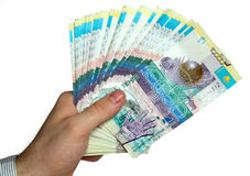 Hand with kazakh money. Isolated on white Royalty Free Stock Image