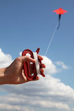 Hand keep fly kite. In sky, position 3 Royalty Free Stock Image