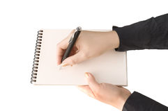 Hand keep notebook and other hand keep pen and wri Royalty Free Stock Images