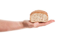 Hand keeping loaf of baked bread Royalty Free Stock Photos