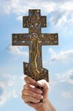 Hand keeps christian cross Royalty Free Stock Photo