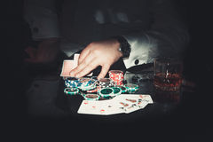 Hand keeps the poker card. Hands hold the cards in the game of Poker stock photography