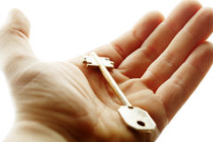 Hand with a key Stock Photo
