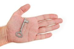 Hand with a key Stock Photography