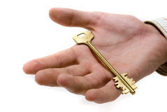 Hand with key Royalty Free Stock Image