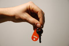 Hand and key Royalty Free Stock Photo