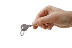 Hand with key Royalty Free Stock Images