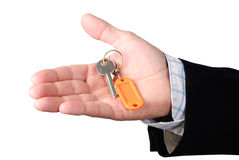 Hand with key. Open right hand with a key and a keyring Royalty Free Stock Photography