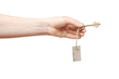 Hand and key with blank label Stock Photos