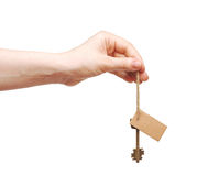 Hand and key with blank label Royalty Free Stock Image
