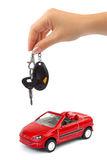Hand with key and car. Isolated on white background Stock Photography