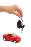 Hand with key and car Stock Images