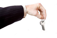 Hand and key conceptual image. Businessman hold the keys Royalty Free Stock Photography