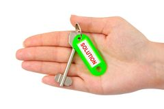 Hand and key with label Solution Royalty Free Stock Image