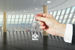Hand with key from a new big loft Royalty Free Stock Images