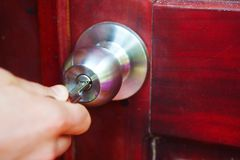 Hand with key opens door Royalty Free Stock Photography