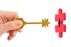 Hand with key and puzzle Stock Images
