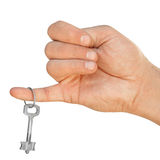 Hand with key on a white background Royalty Free Stock Images