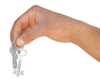 Hand with key on a white background Stock Photography
