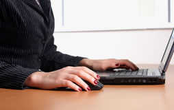 Hand with keyboard. Hand with black keyboard press the buttons royalty free stock image